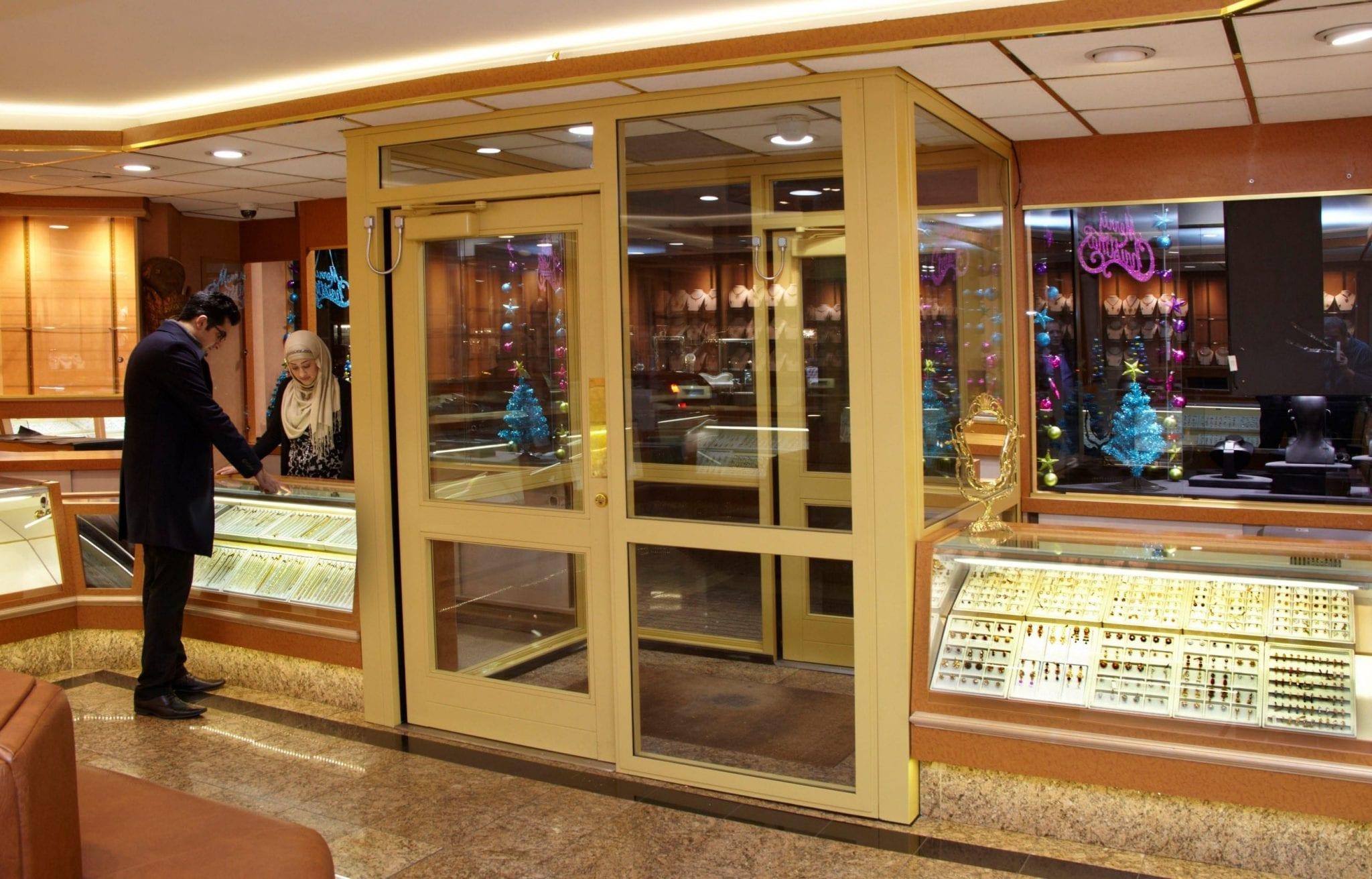 Warrior Fully Glazed Sliding Interlocking Doors from the inside of a jewellery shop