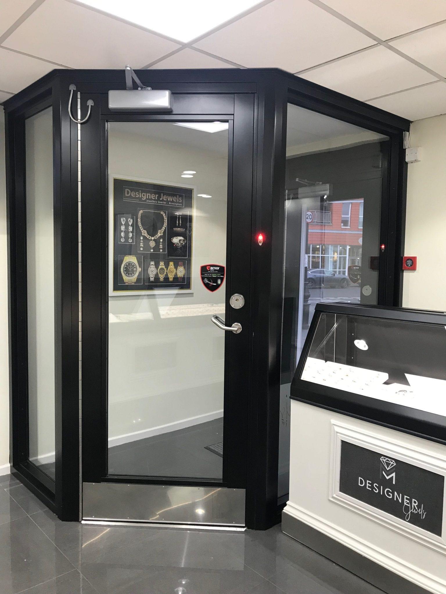 Warrior Fully Glazed Interlocking Swing Doors from the inside of a jewellery shop.
