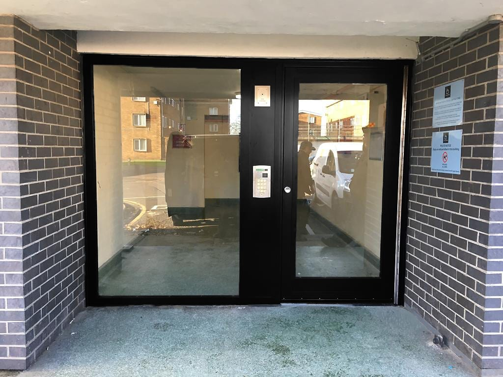 Warrior Fully Glazed Communal Entrance Door & Screen on a Communal Residential Building