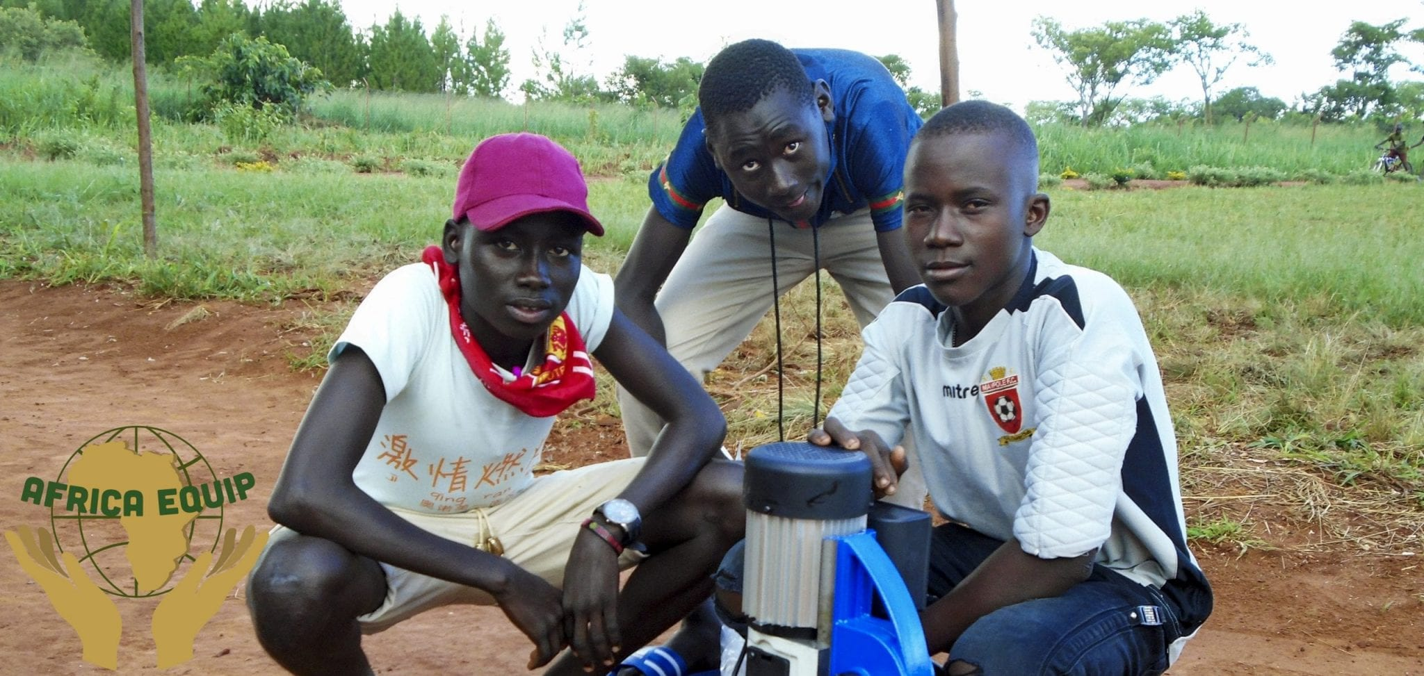 3 young boys posing with equipment sent to them by africa equip
