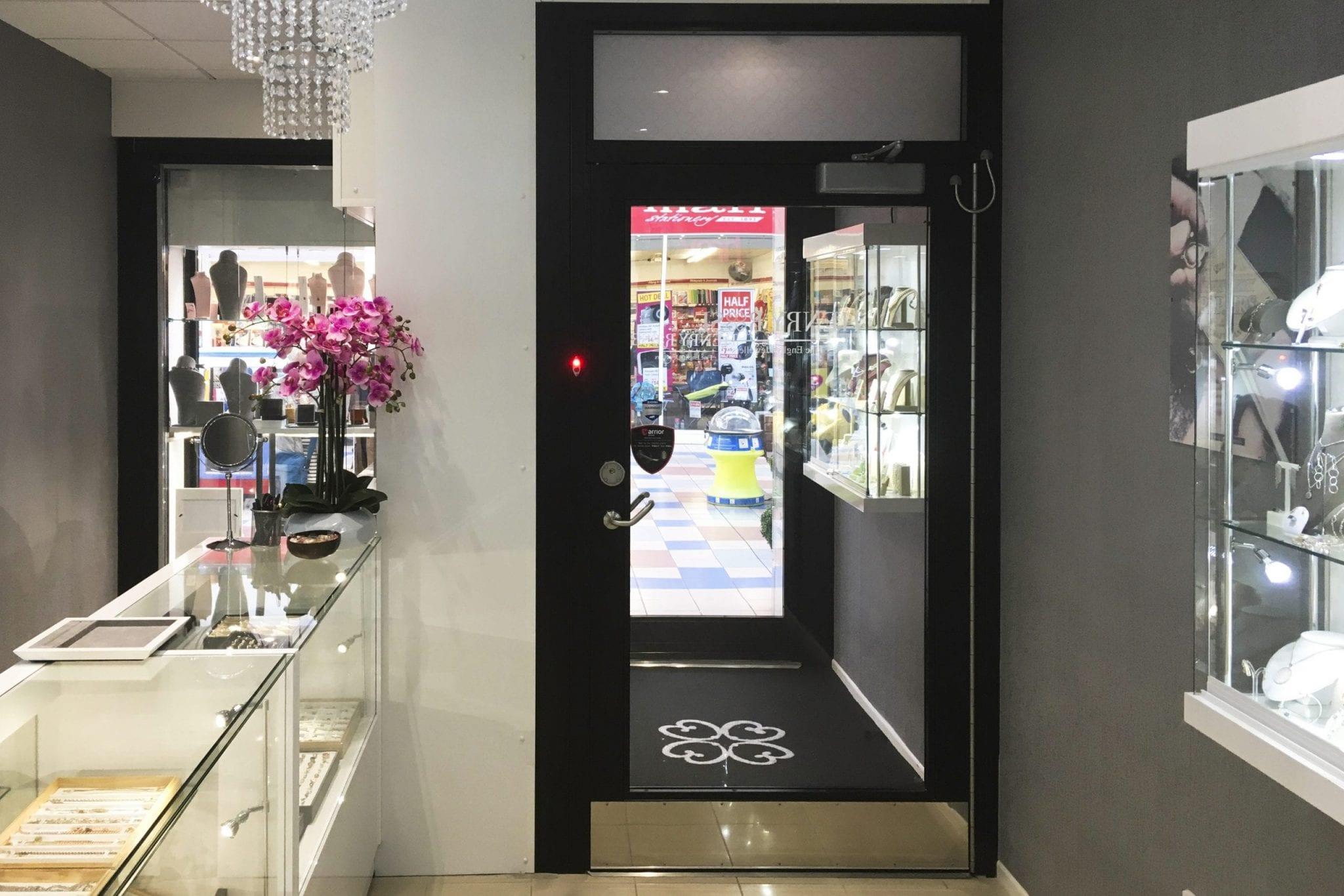 Warrior Fully Glazed Interlocking Doors Swing & Sliding Door Combination from inside Henry Role Jewellers