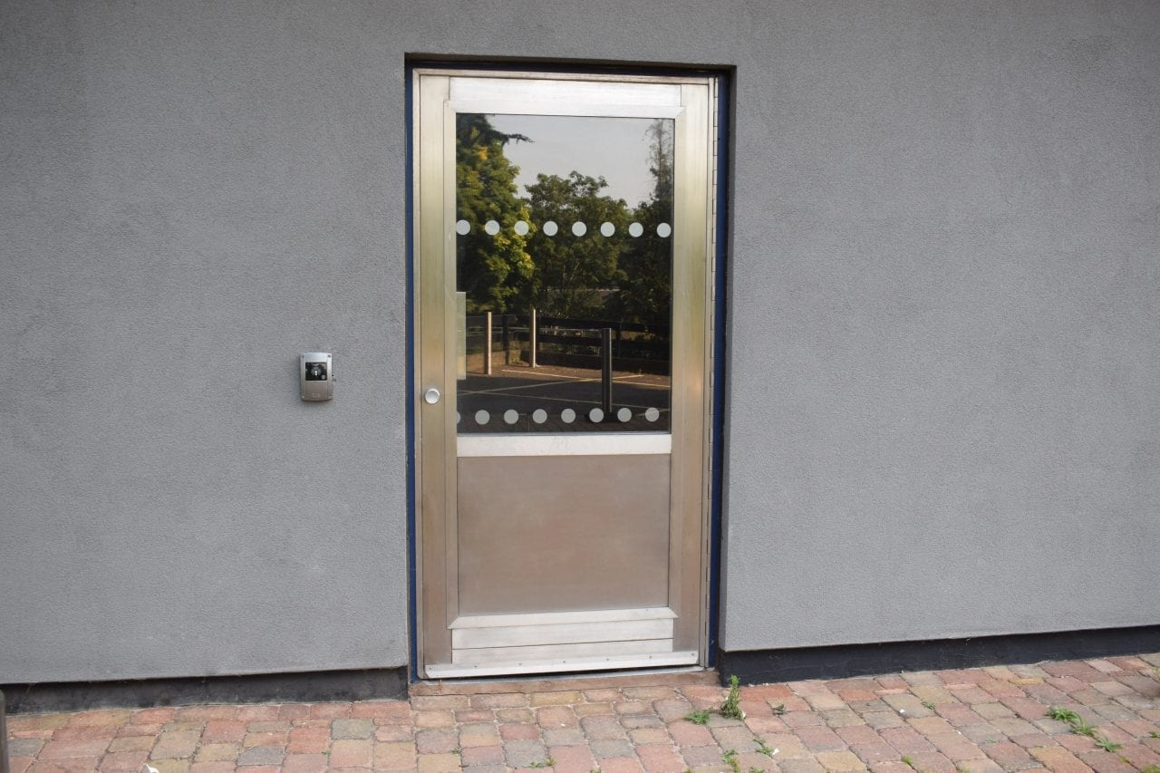 Warrior Bike Store Door with fully glazed top vision panel and stainless-steel anti-scuff bottom panel