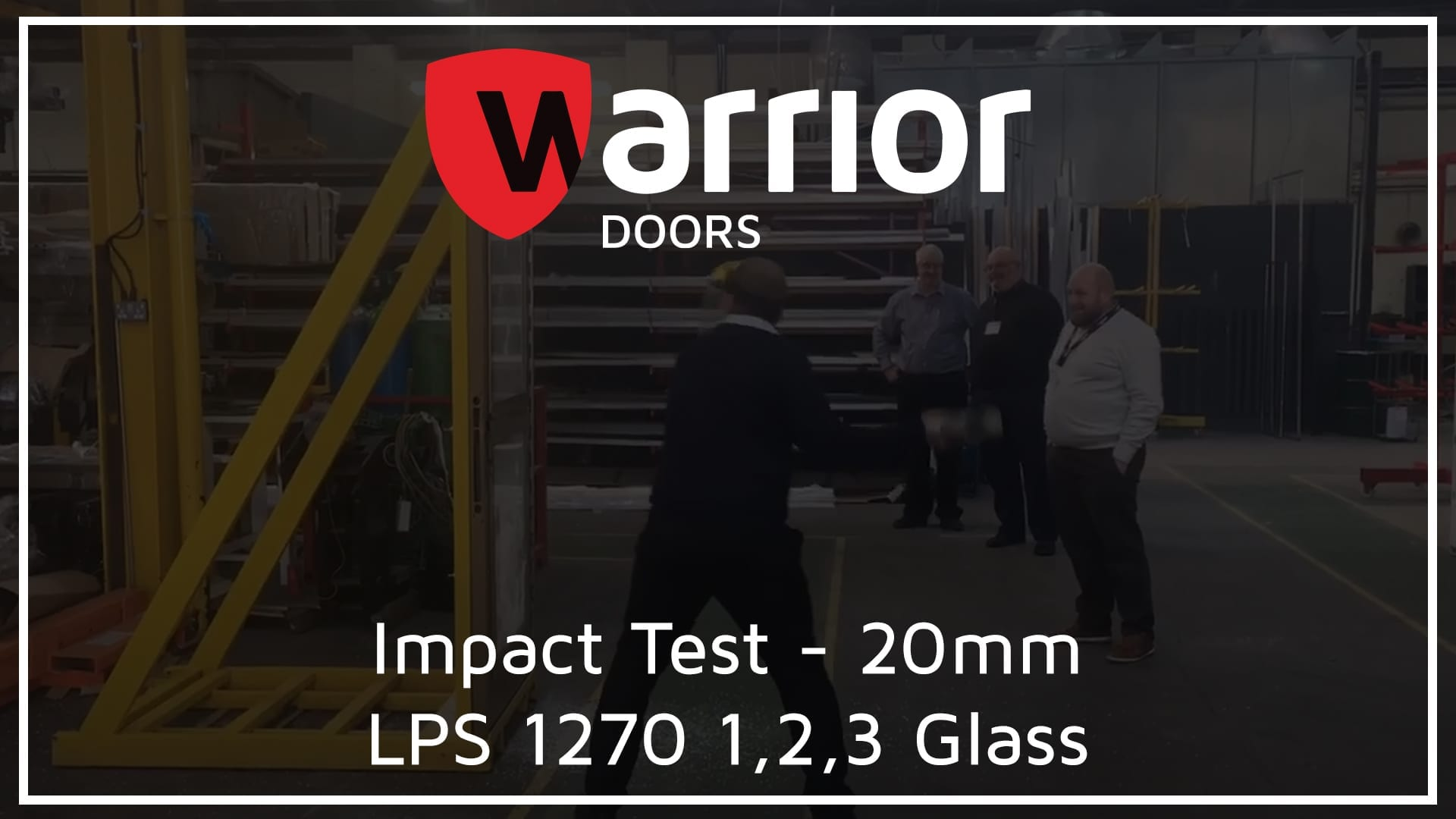 """Man hitting a door with a sledgehammer with 3 men watching with Warrior Doors Logo and text reading """"Impact Test - 20mm LPS 1270 1,2,3 Glass"""""""