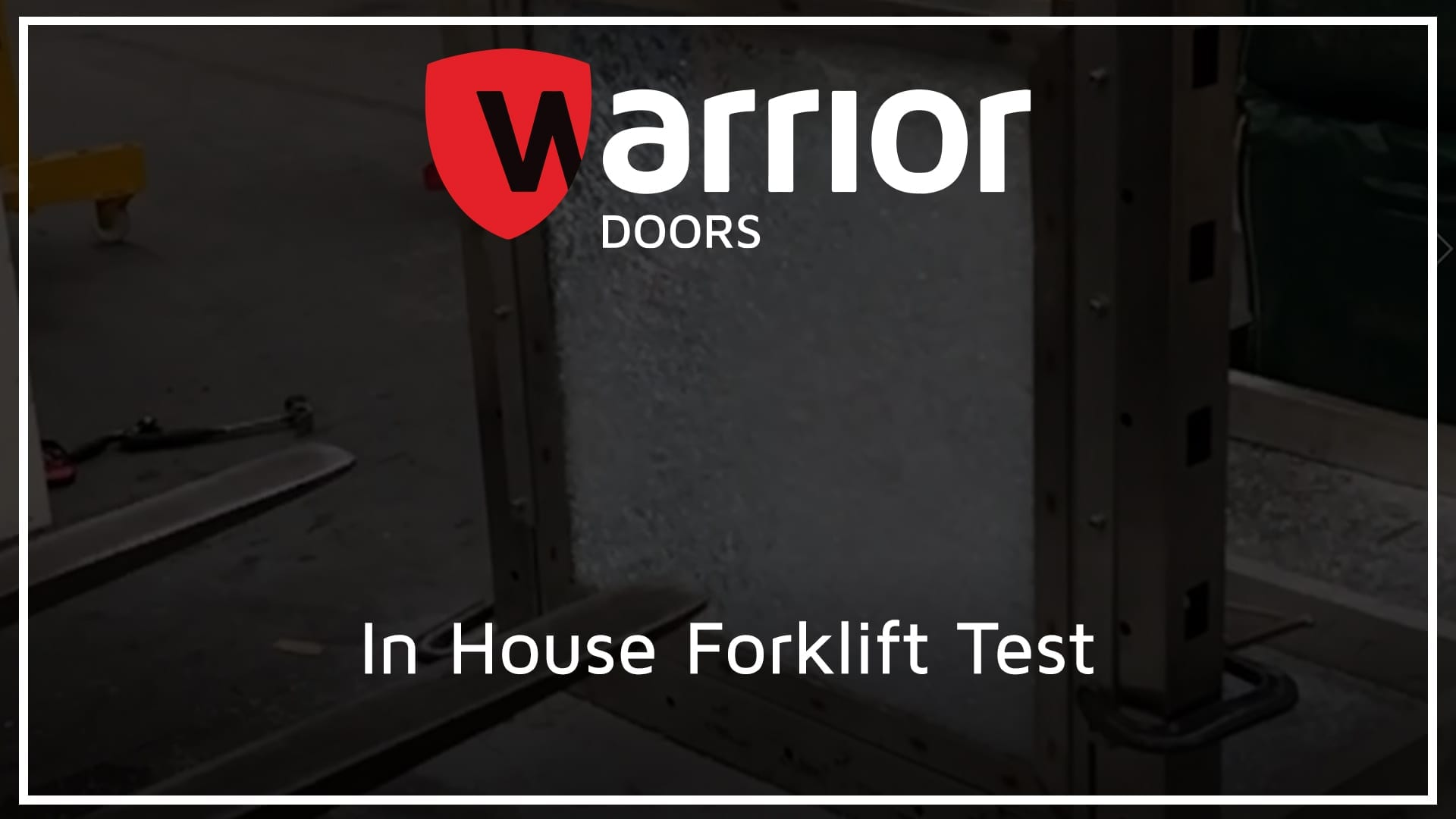 """Forklift hitting glass panel with Warrior Doors Logo and text reading """"In House Forklift Test""""."""
