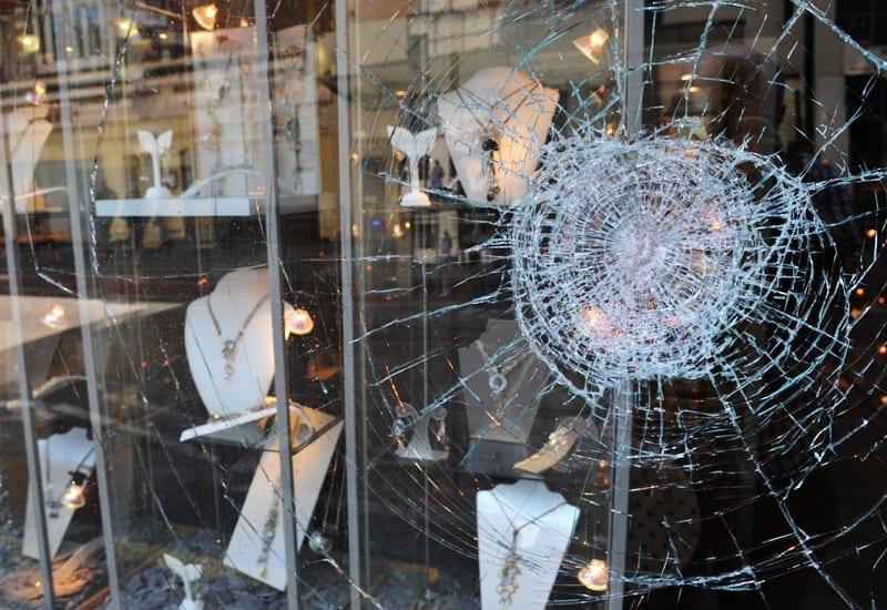 smashed window on jewellery shop