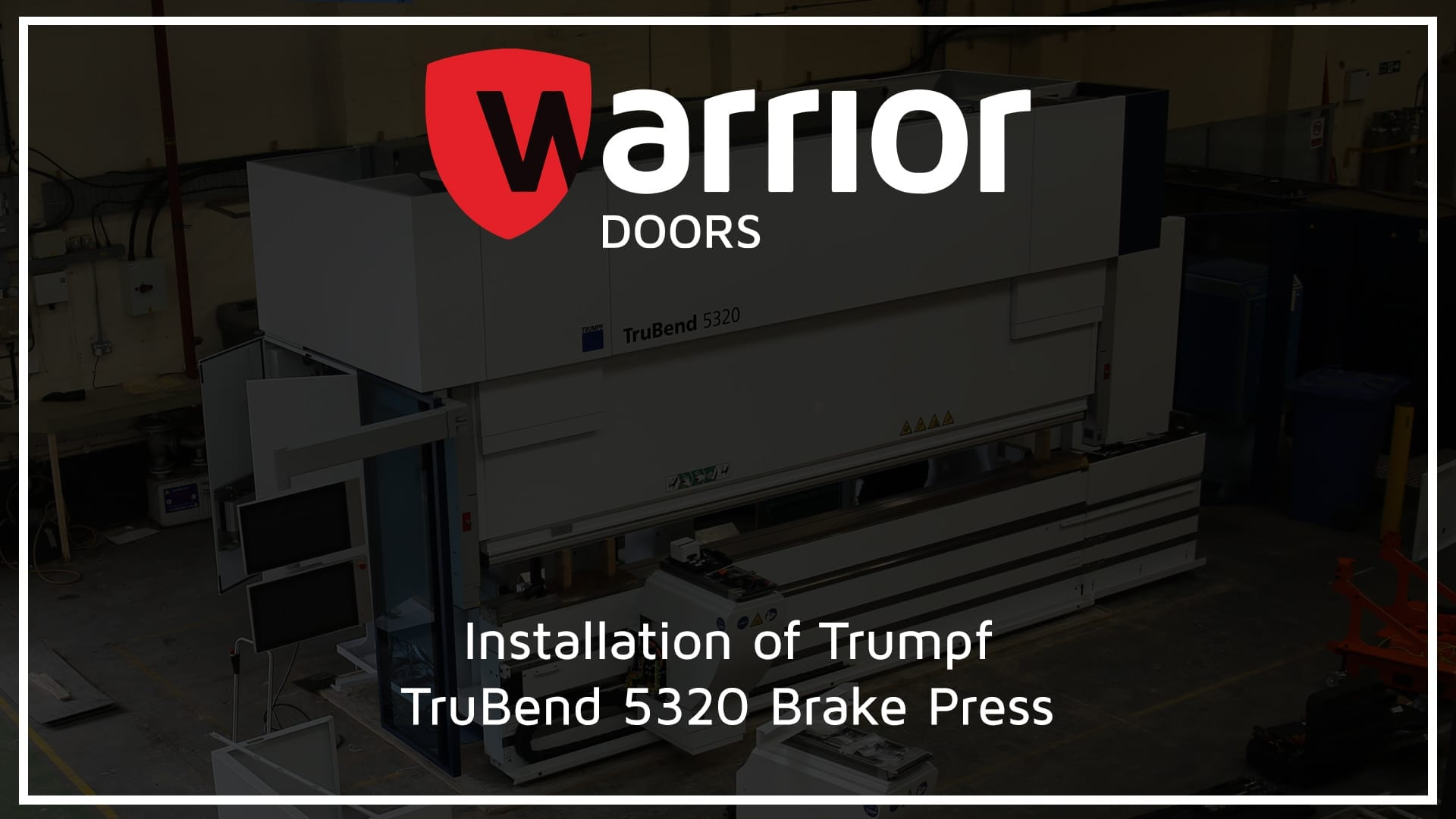 """Trumpf TruBend 5320 Brake Press inside a factory with Warrior Doors Logo and text reading """"Installation of Trumpf TruBend 5320 Brake Press"""""""