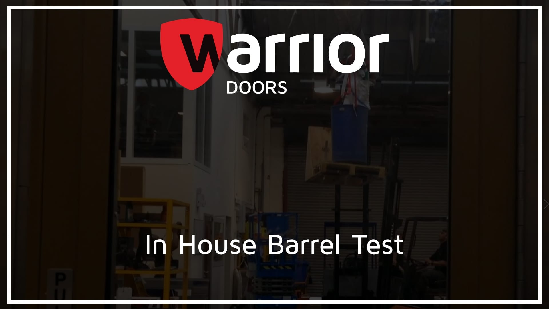 """barrel attached to ropes being launched at a door with Warrior Doors Logo and text reading """"In House Barrel Test"""""""