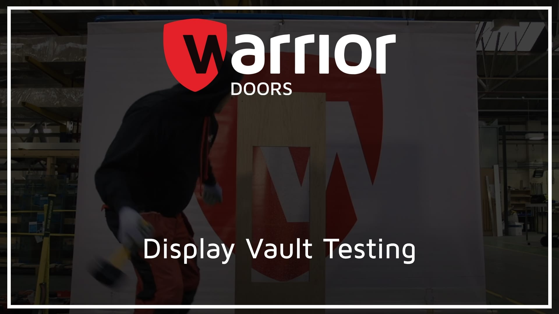 """man hitting display vault with sledgehammer with Warrior Doors logo and text reading """"Display Vault Testing"""""""