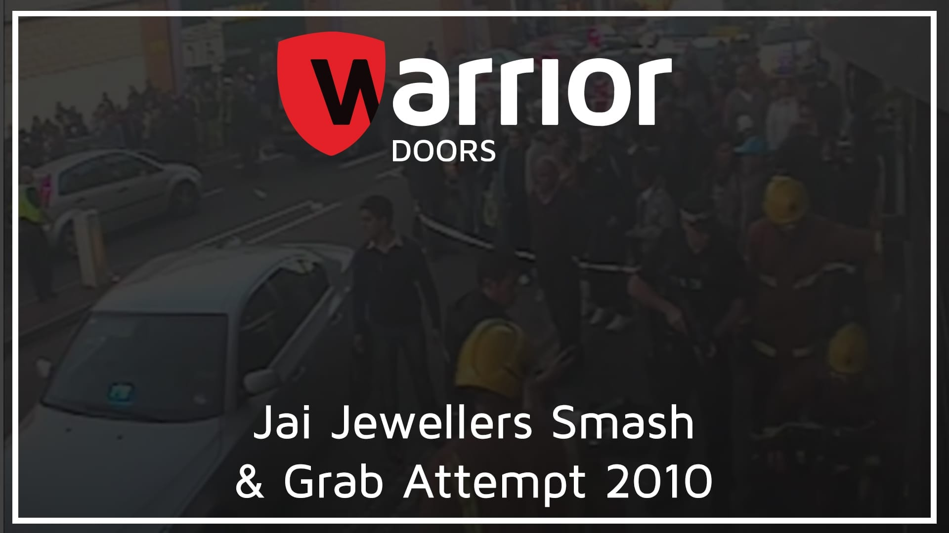 """lots of people and fire brigade outside a jewellery shop with tWarrior Doors Logo and text reading 2Jai Jewellers Smash & Grab Attempt 2010"""""""