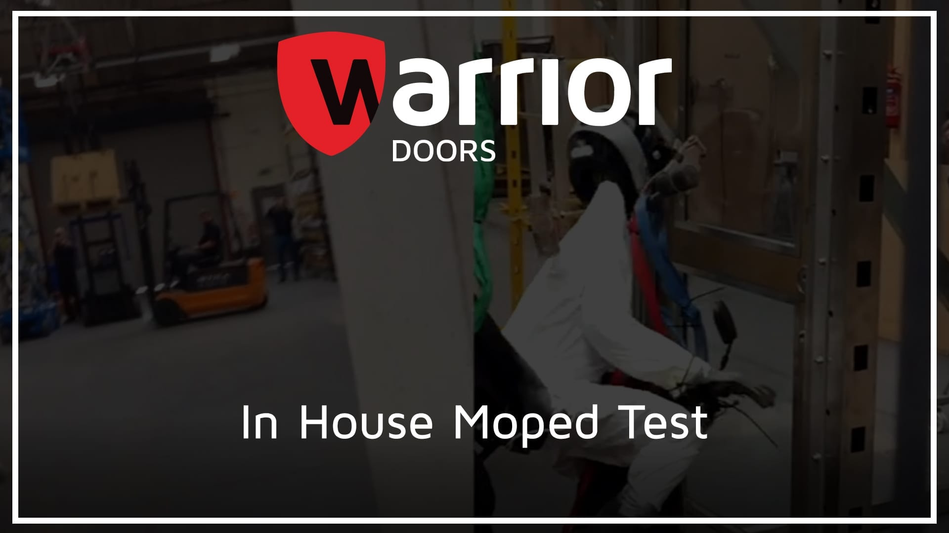 """dummy on a moped driving into a door with Warrior Doors logo and text reading """"In House Moped Test"""""""