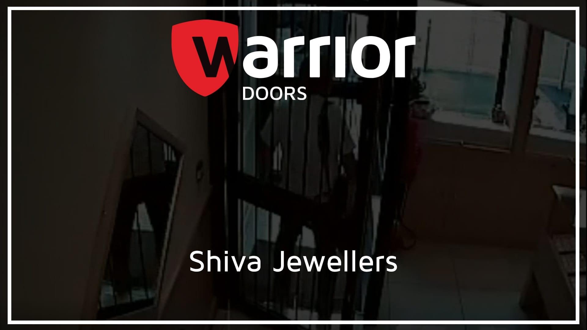 "man inside interlock with Warrior Doors logo and text reading ""Shiva Jewellers""."