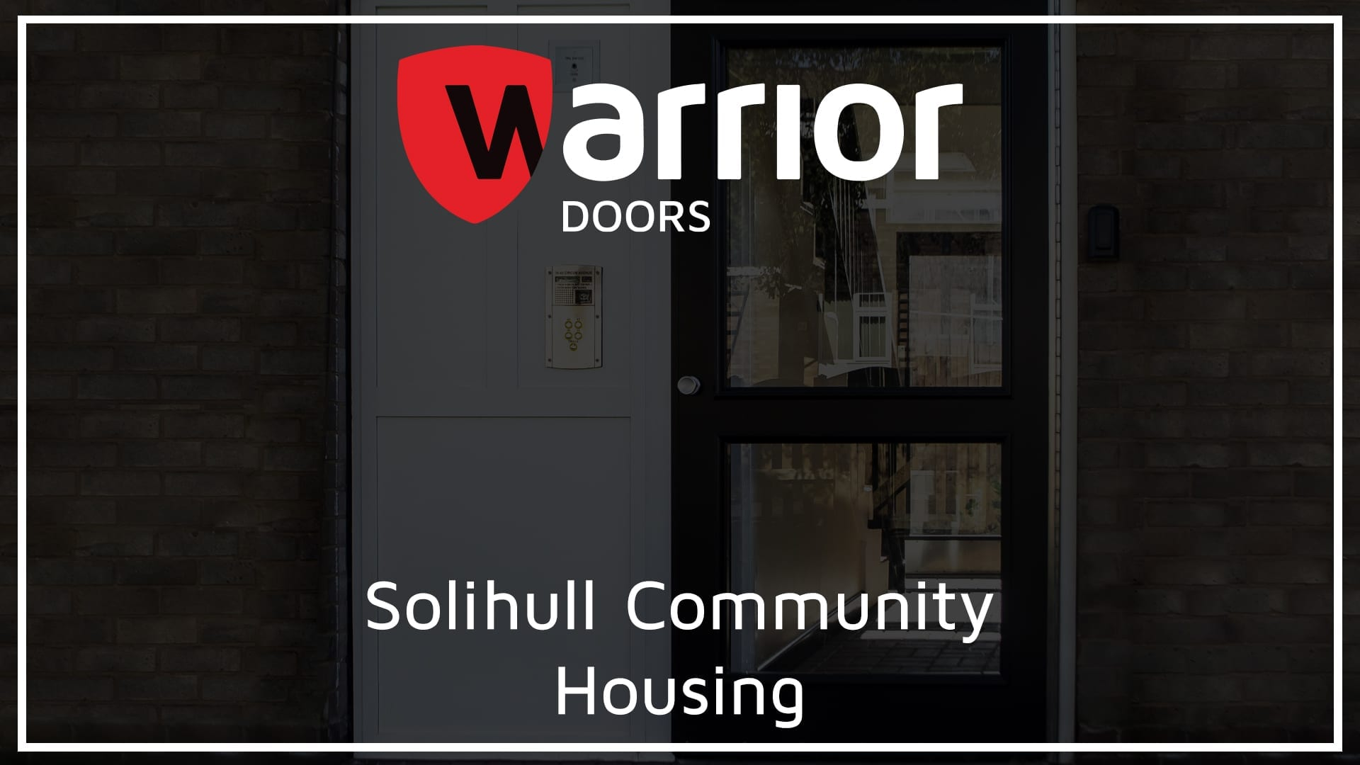 """Warrior communal entrance door with Warrior Doors Logo and text reading """"Solihull Community Housing"""""""