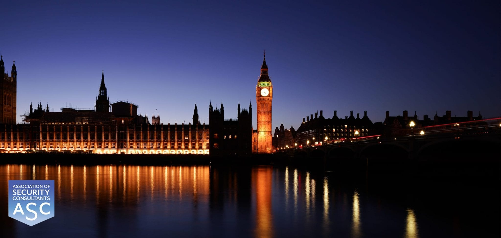 Houses of Parliament and Big Ben from across the river Thames at night.