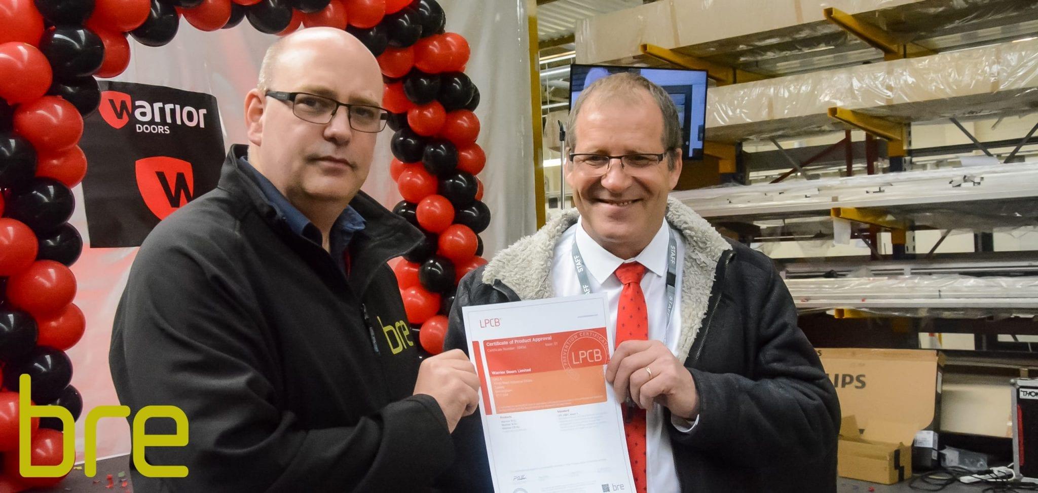BRE handing Managing Director Brett Barratt an LPS 2081 SRB Certificate