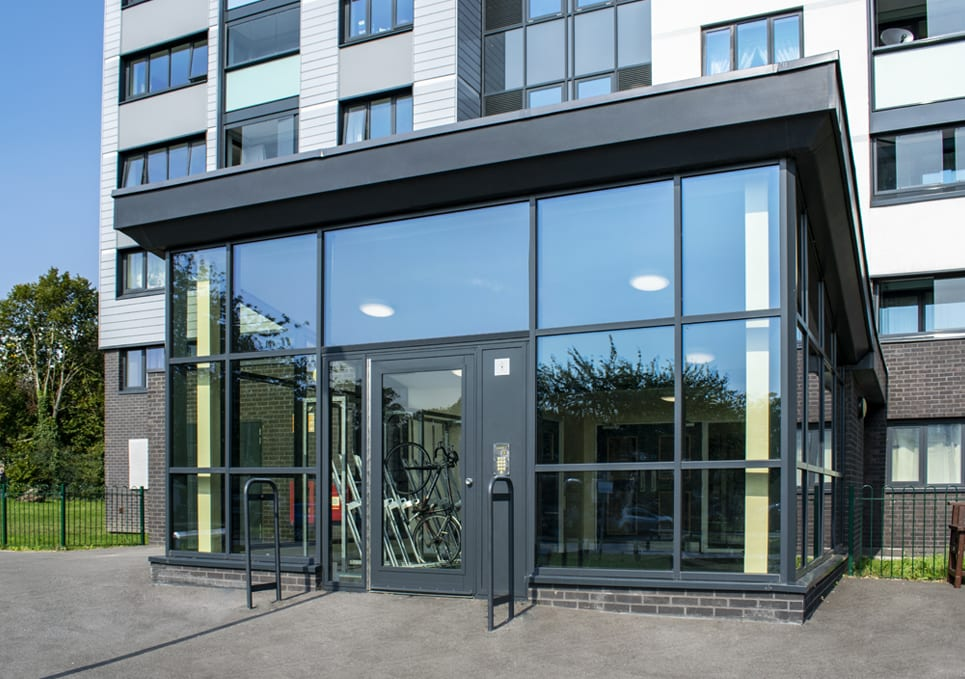 Warrior fully glazed Swing Door on a glass lobby of a block of flats.