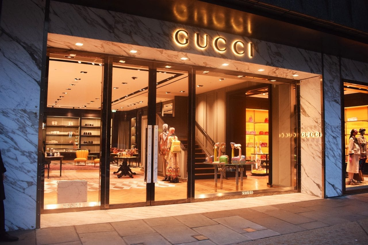 Outside Gucci's flagship store in sloane street at night. Large bespoke fully glazed Warrior Doors and shopfront.