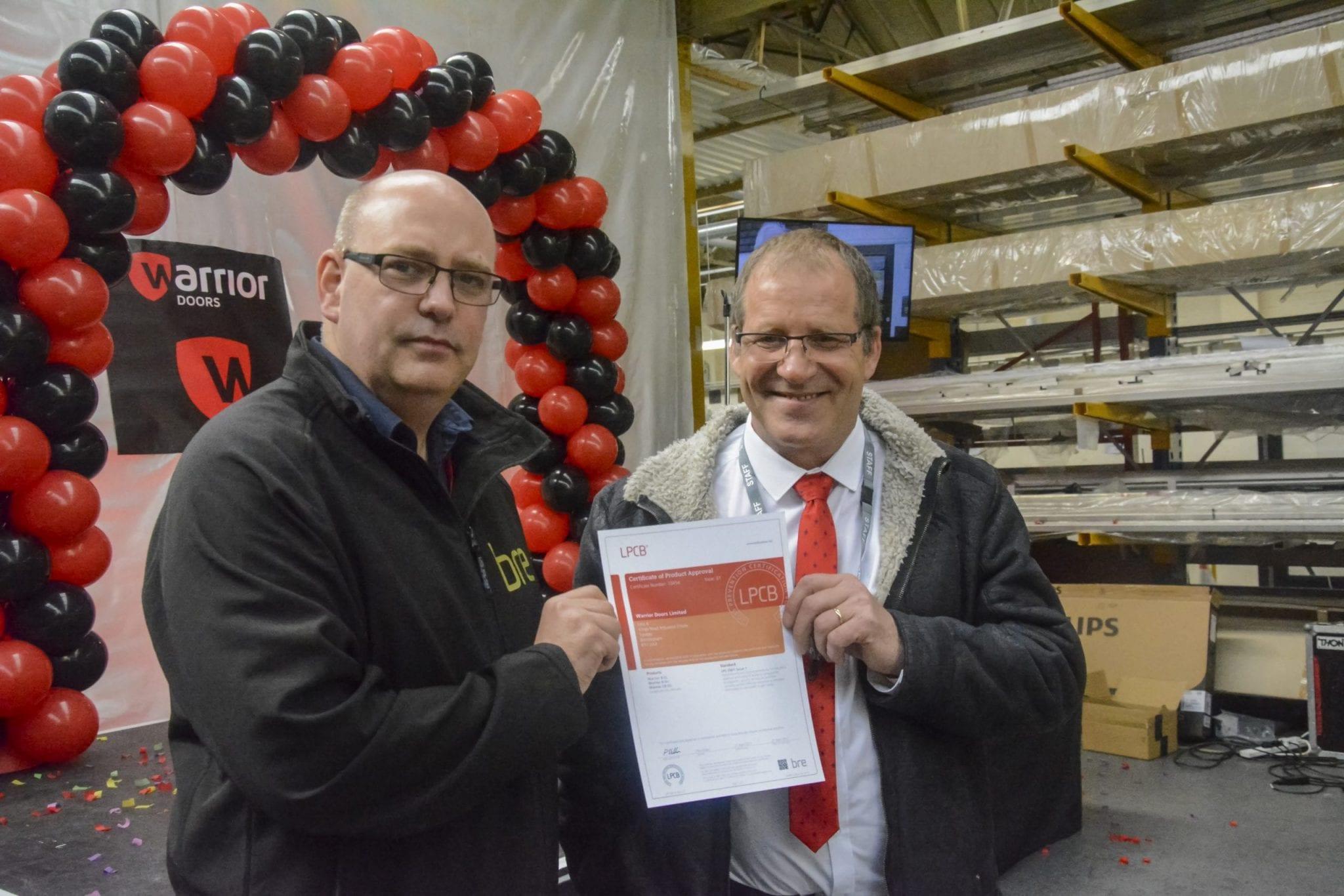 BRE and Managing Director Brett Barratt holding the certificate for LPS 2081 SRB.