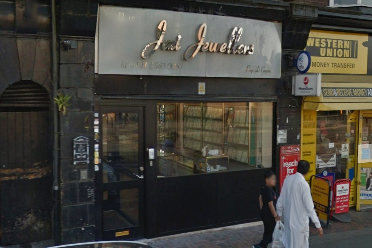 "Jewellery store with black Warrior Interlock and Shopfront. Large silver sign that reads ""Jai Jewellers"""