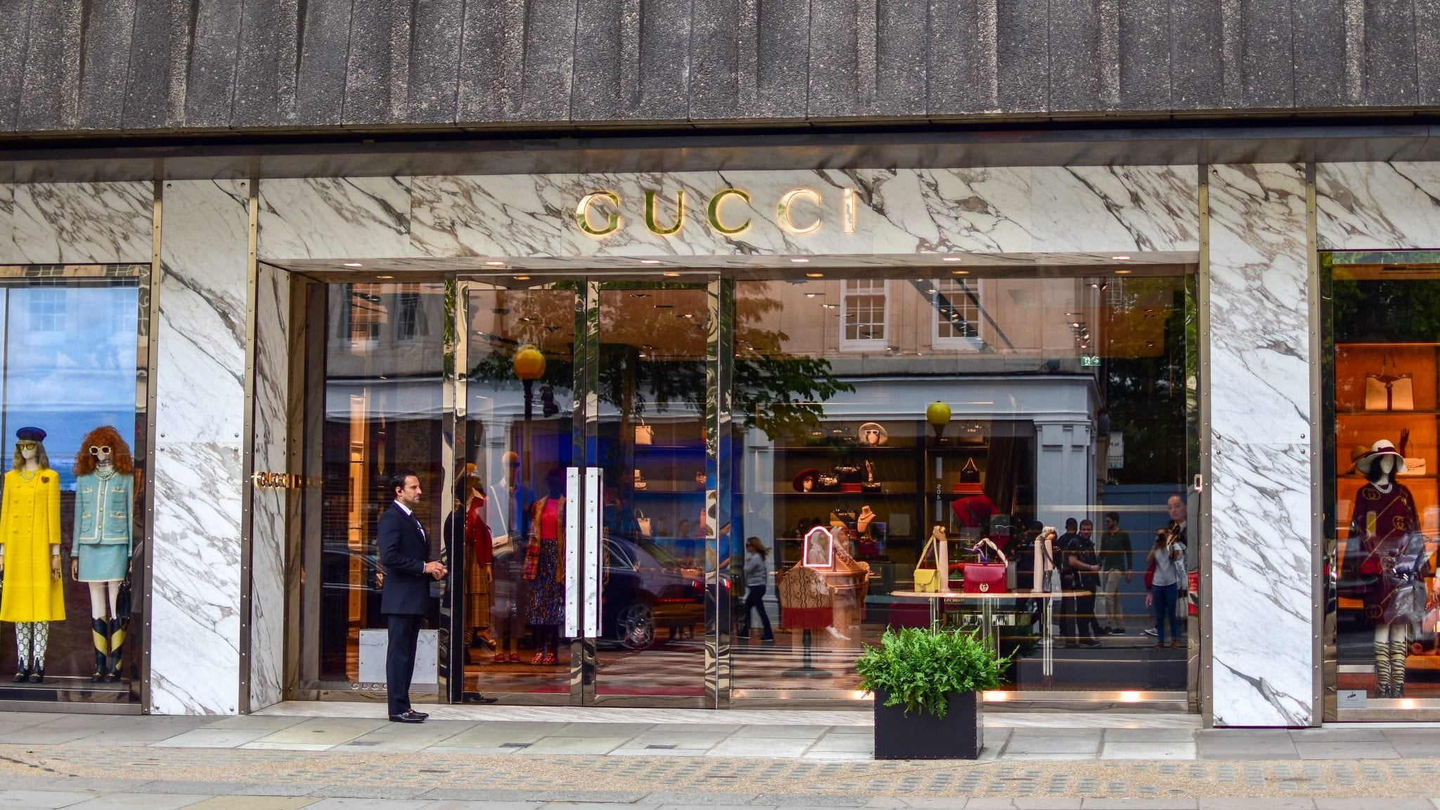 Outside Gucci's flagship store in sloane street. Large bespoke fully glazed Warrior Doors and shopfront with a security guard on duty.