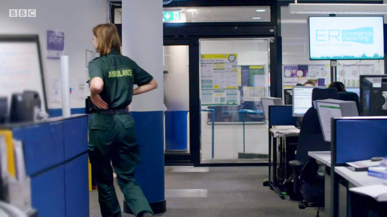 Warrior Sliding Door inside a hospital with ambulance staff around
