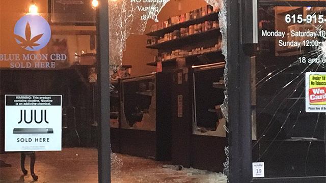 smashed glass door on a vape shop