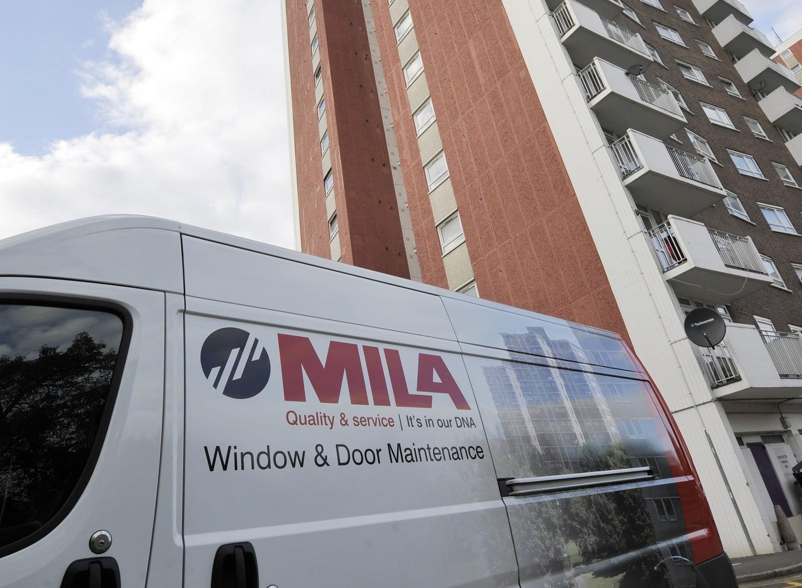 Mila Maintenance van outside a block of flats