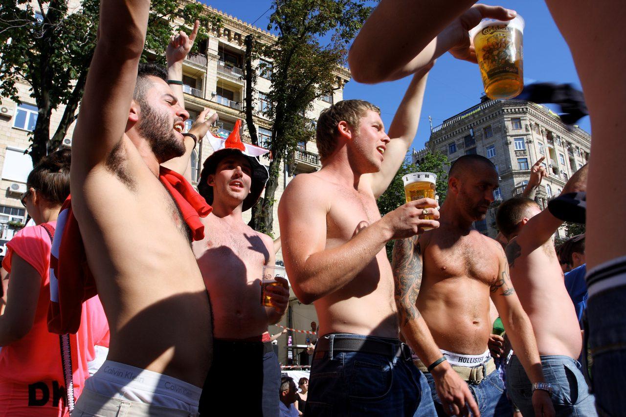 Football fans topless & drinking in public