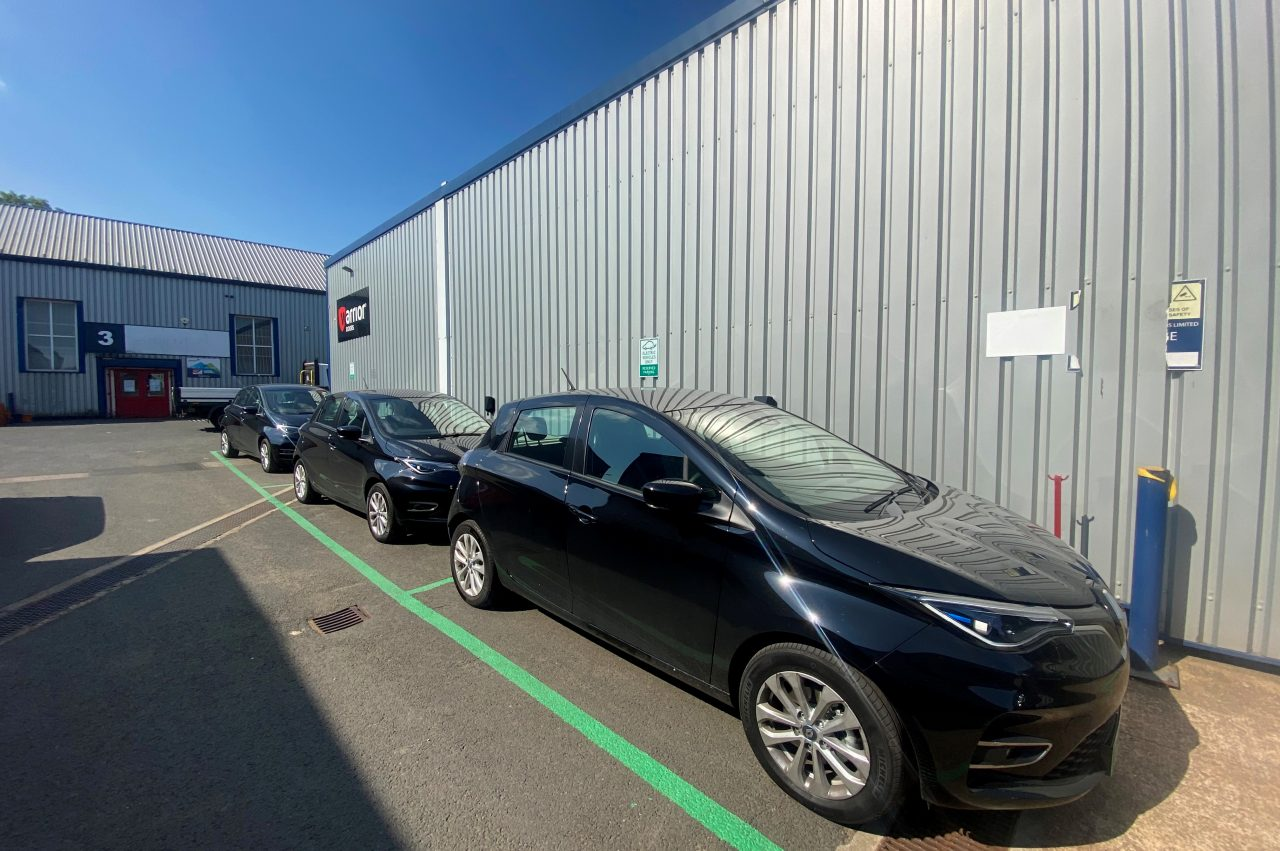 row of Renault Zoes parked outside of the Warrior Doors Factory