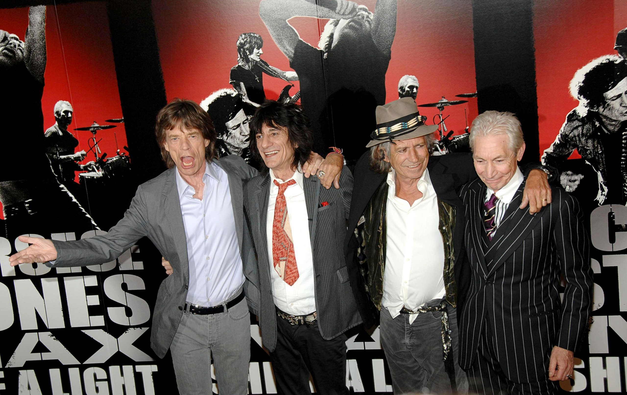 The rolling stones linking arms