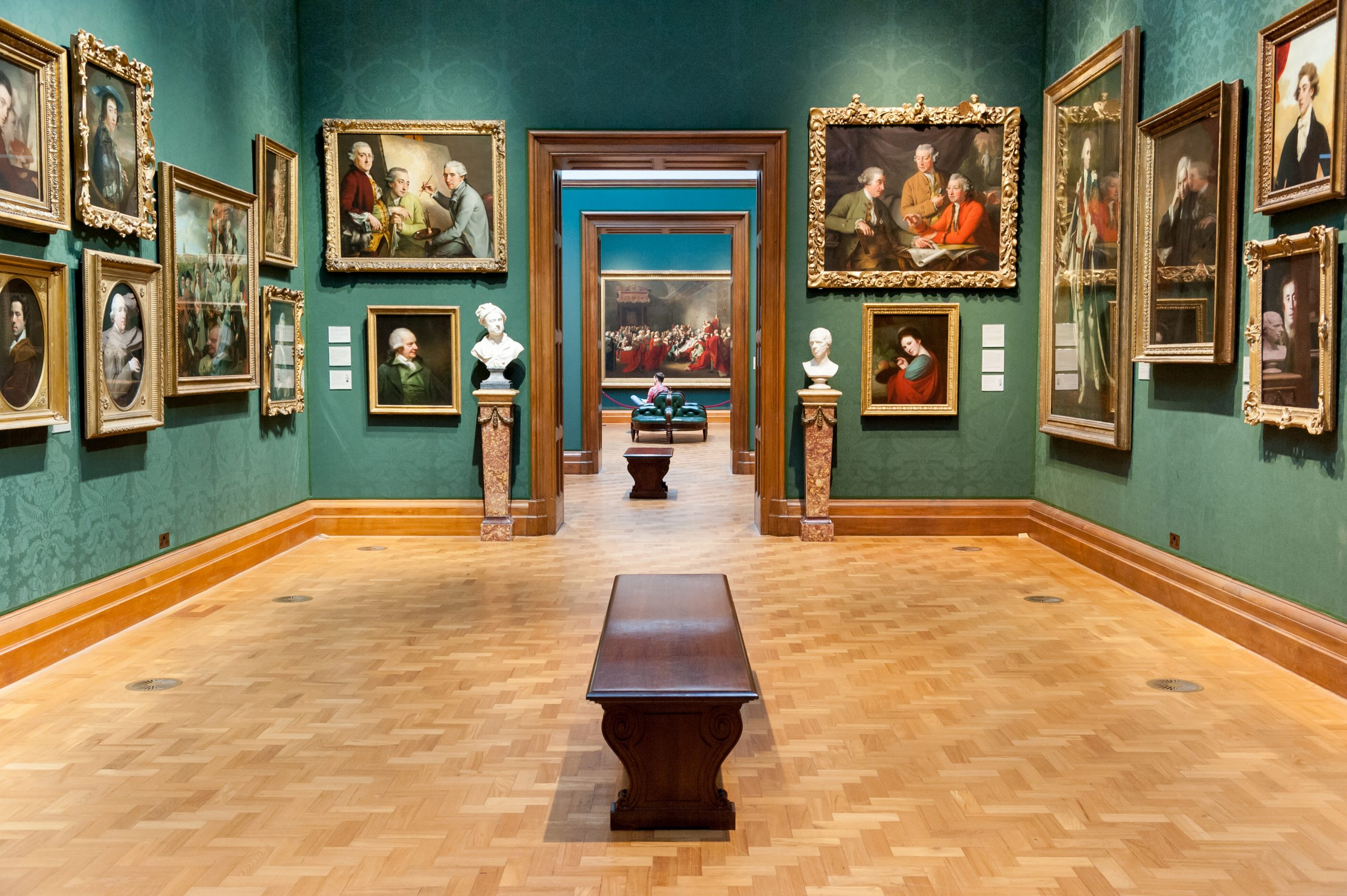 art gallery filled with historical paintings