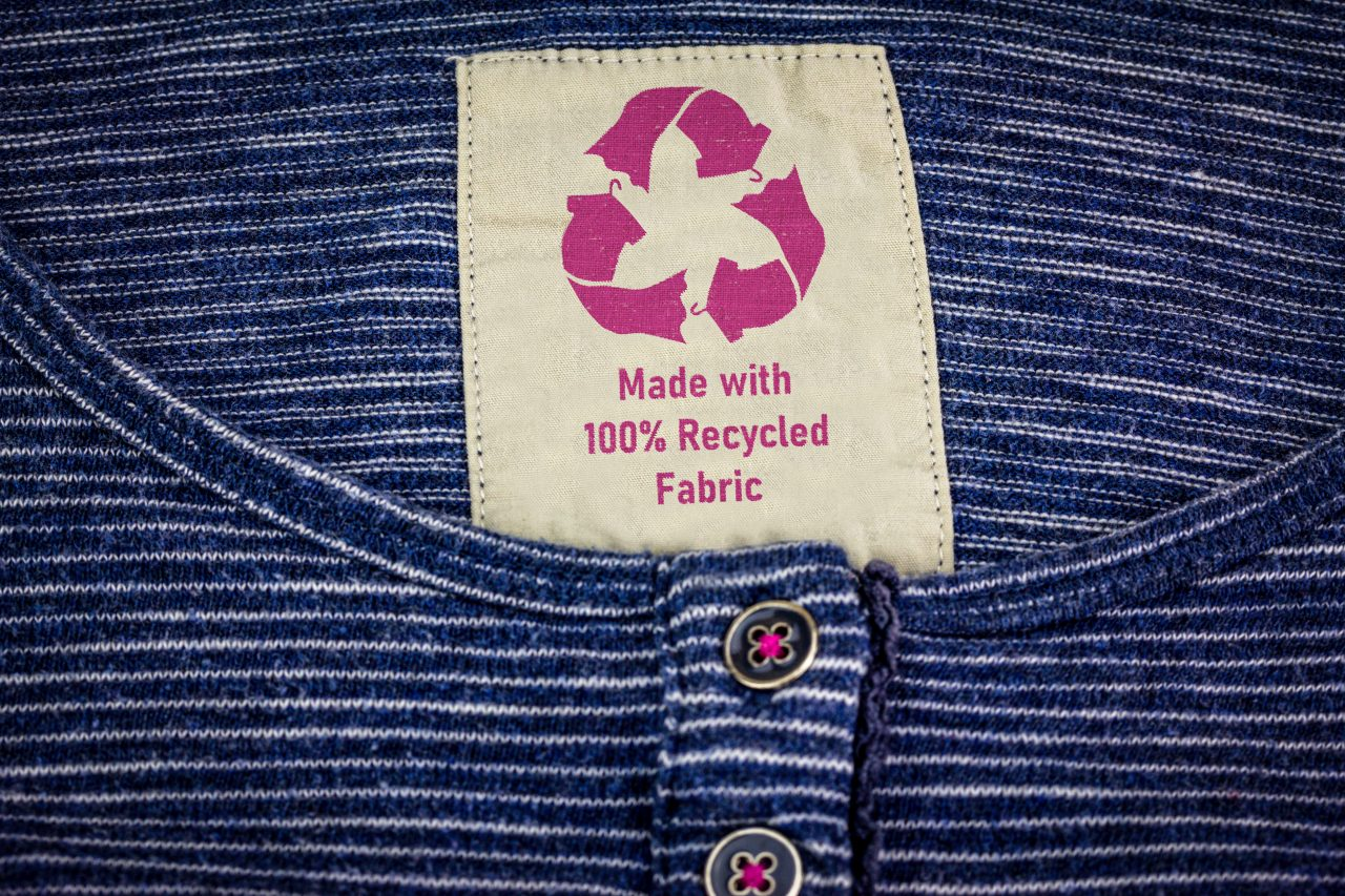 tshirt with label that says 100% recycled materials